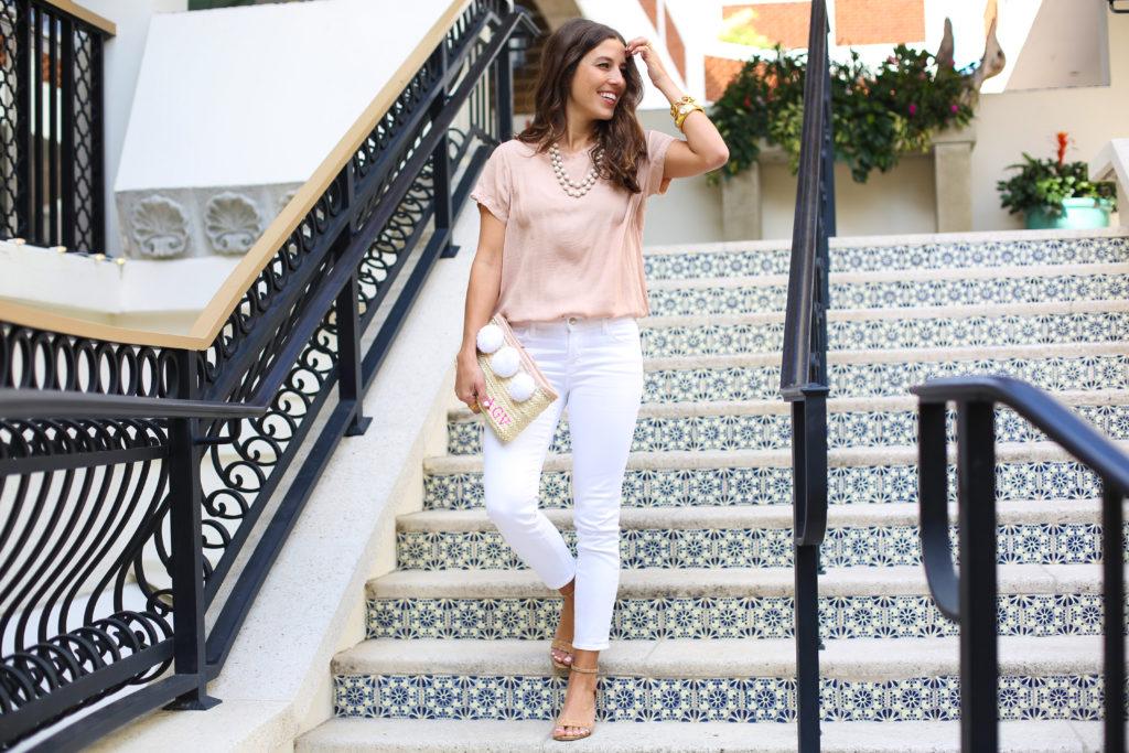 Pom Pom Clutch & white jeans