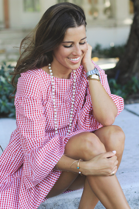Red Gingham Day Dress smiles