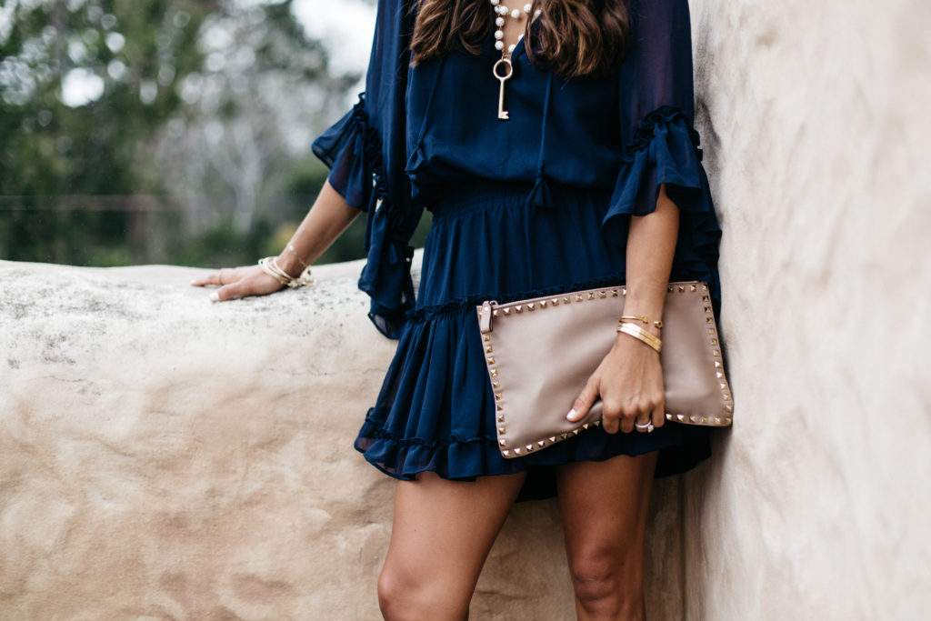 Navy Dress with Tassels & Valentino Clutch